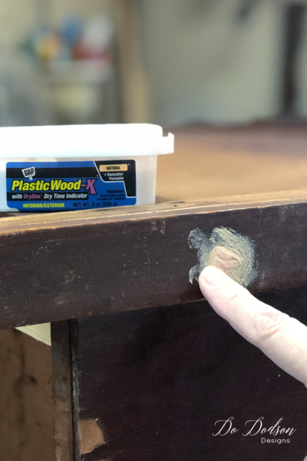 Add extra wood filler to cover the holes and allow them to dry.