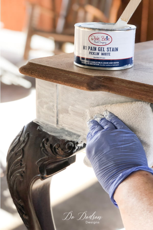 Now the easy part! Apply the whitewash pickling stain over the raw clean wood with a staining pad and wipe back any remaining stain with a soft cloth. The whitewash wood on this table top is going to look amazing!