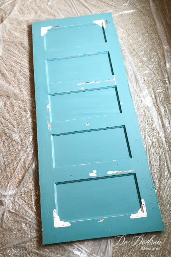 This old door is getting a makeover with the addition of hairpin legs. It's going to make the perfect DIY desk.