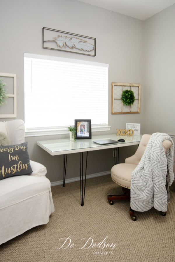 My home office is complete with my easy DIY hairpin leg desk made from an old door. You gotta try this idea!
