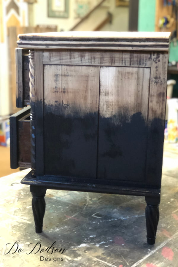 Using a paintbrush, I started by painting up into the raw wood and stopped where I wanted to blend the paint into the wood.
