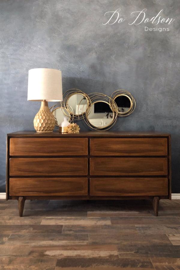 Mid Century Modern Dresser refinished with dark walnut gel stain. Get the DIY tutorial now!