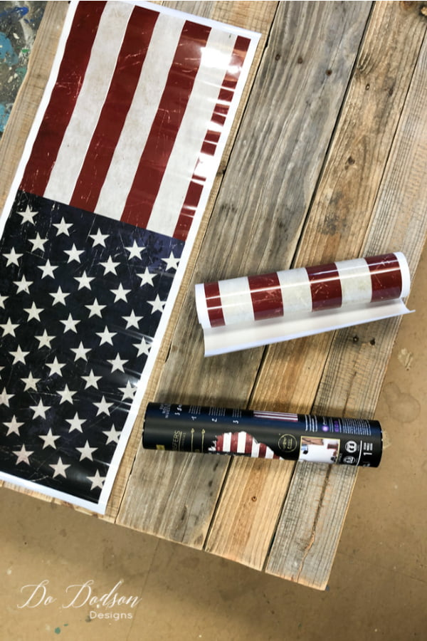 It all started with an American Flag transfer... my inspiration for this project. I wasn't so sure about putting it on furniture... not my style. But an American flag pallet sign is DO-able and I have just the spot on my front porch that needs a little patriotism. I don't think you can ever have too much red, white, and blue.