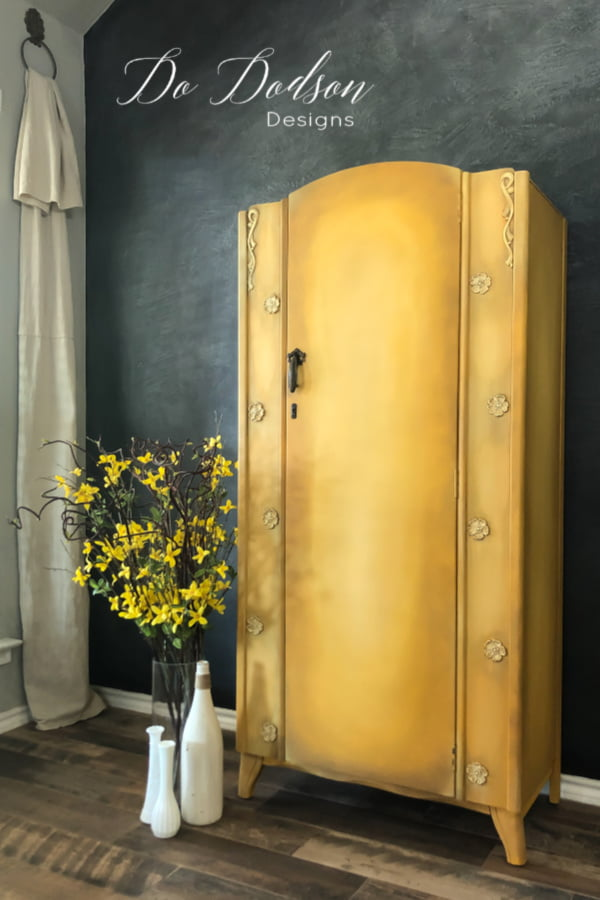 I love the way blending chalk paint on furniture with water creates a cohesive look with colors. This yellow armoire looks amazing!