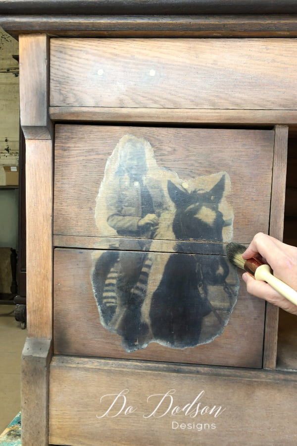 Once the topcoat is dried, try adding accents of wax over the transfer. For this project, I used white and black wax. It's a great way to add depth and a ton of character to your wood project pieces and photo transfers.