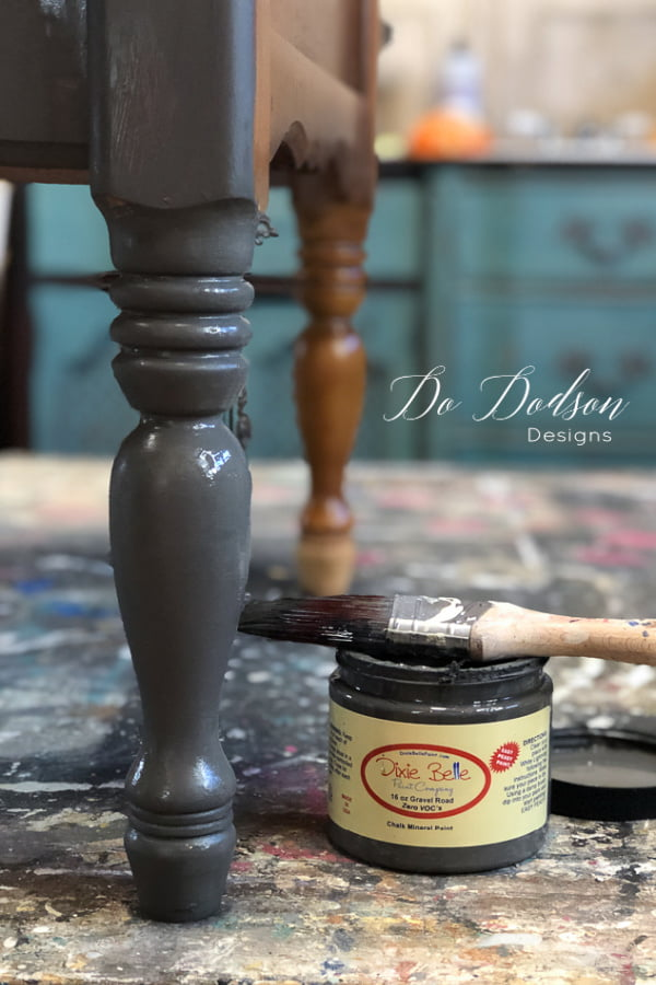 With a layered paint look on furniture, I like to start with a dark color as my base coat.