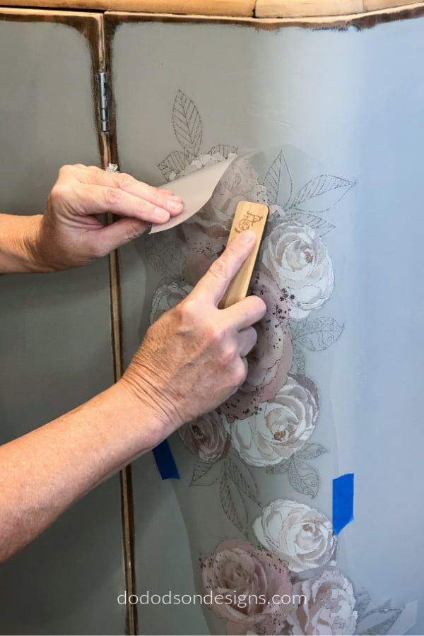 All I did was rub the furniture transfer on my painted furniture for a truly amazing look. I even customized it by layering the floral design.