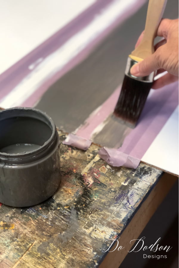 With your paintbrush, paint the accent color inside the taped off area.