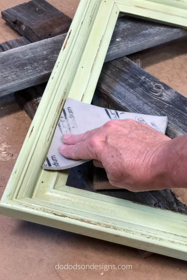 Remove and rough spots by sanding the picture frame before re-painting.