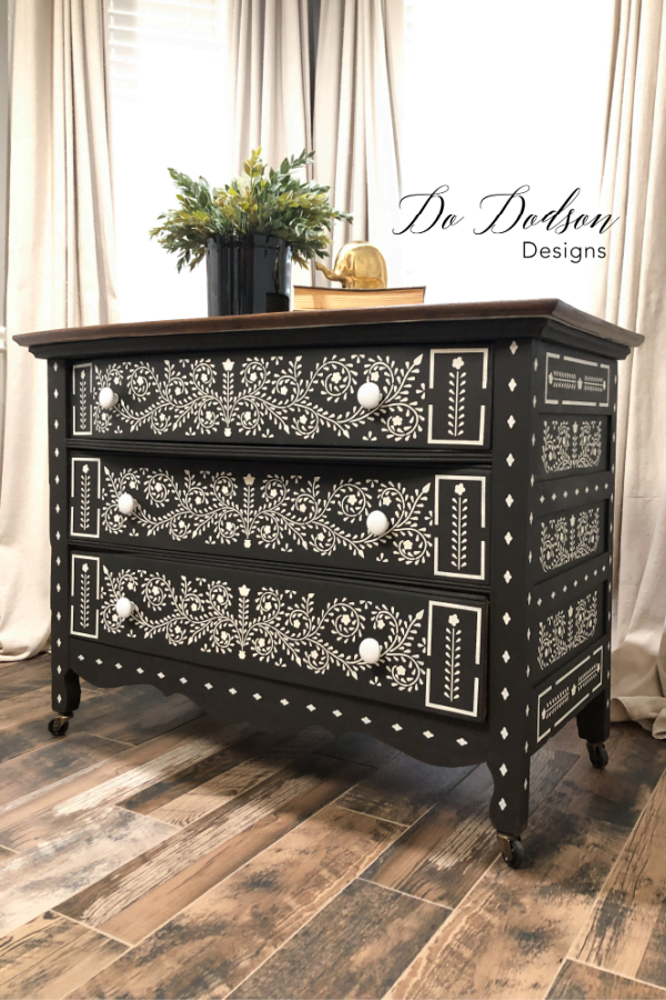 This DIY Bone inlay dresser is stunning painted in black and white. It blends well with my neutral decor.