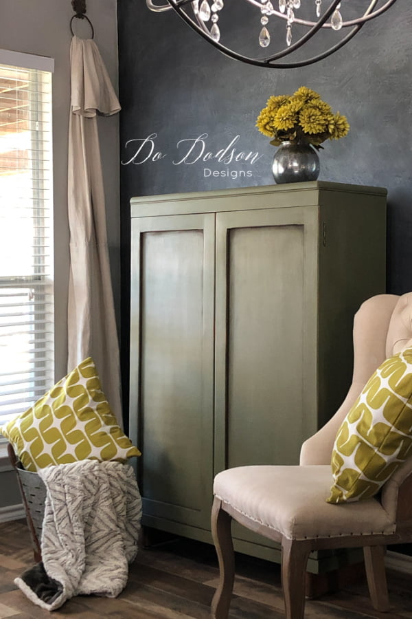 Olive chalk paint and chartreuse accents make this cabinet a winner for sure.