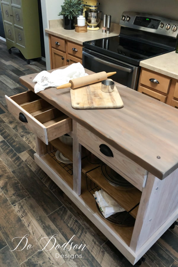 Small kitchen do create a problem when it comes to counter space. I made this DIY rolling kitchen island out of an old cabinet. It was the perfect solution.