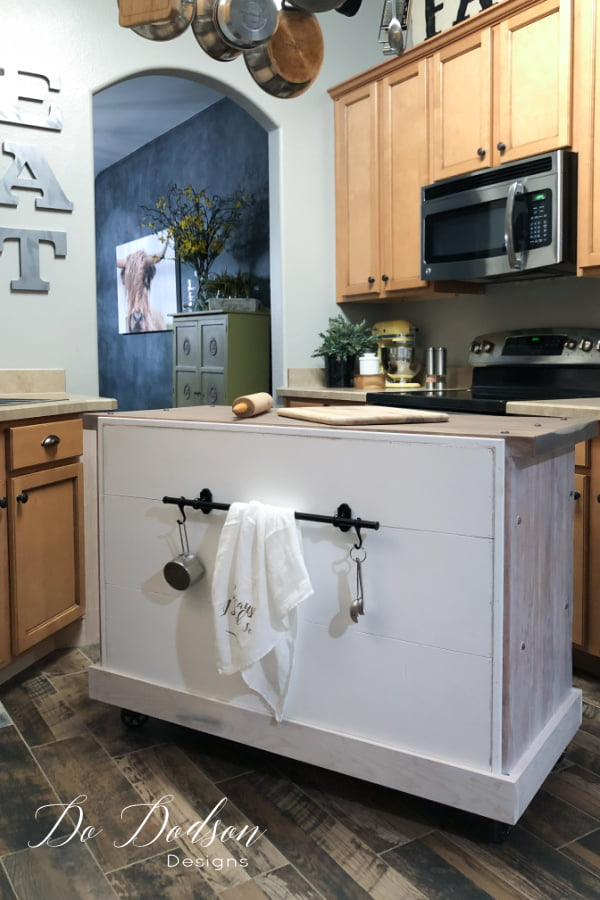 I also used the back of the DIY rolling kitchen island for storage by installing an Ikea steel kitchen organizer. Love those hooks!!!