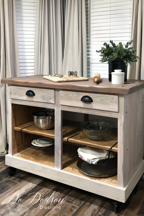 You would never know that this was an old cabinet. It had seen better days for sure! Now it's a rolling kitchen island that is used daily in my small kitchen.  Learn how to DIY one like his on the blog.