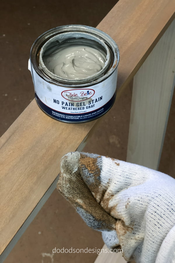 I layer gel stain in different colors on wood for a rust weathered finish.