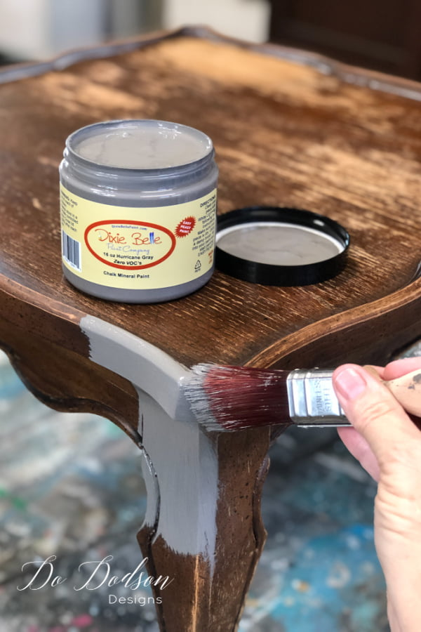 I like to paint the table before adding the tiled table top. This will prevent getting the paint in the grout lines around the edges.