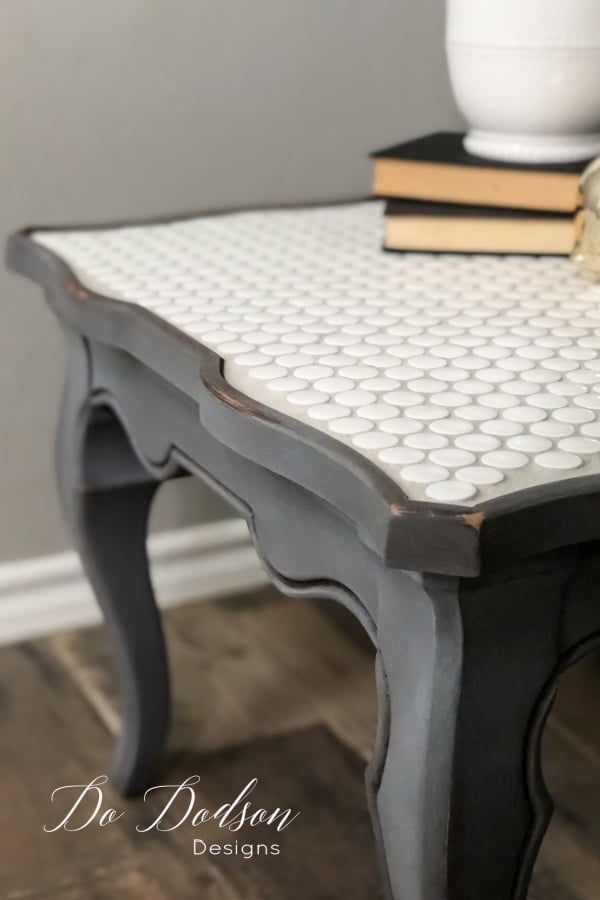 This DIY tiled table top makeover was super easy and budget friendly. The perfect idea for salvaging a table that isn't quite your style.