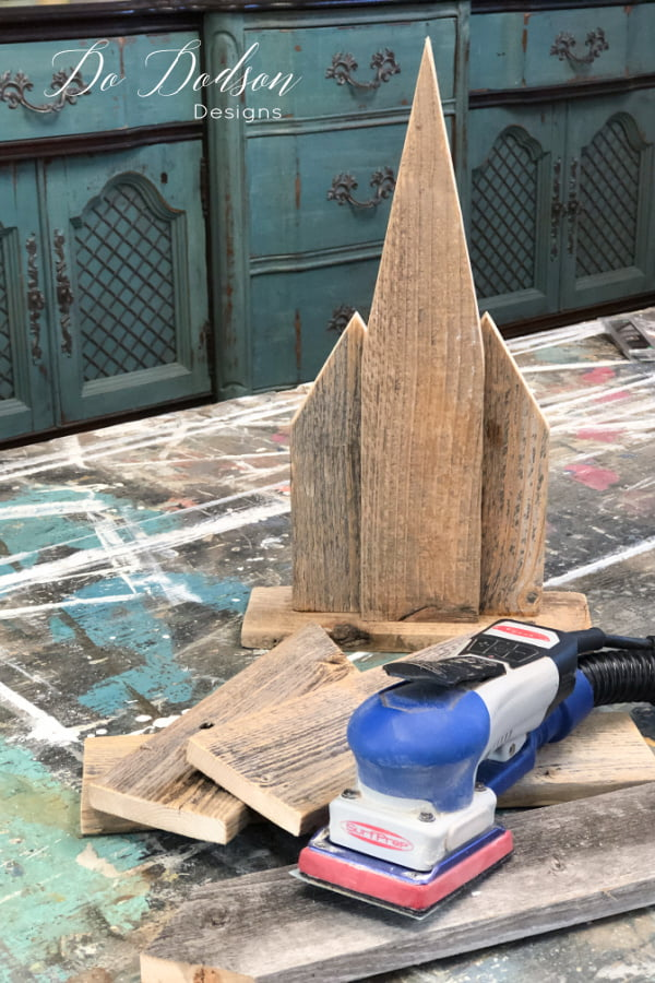 Before assembling the wooden churches, I gave the reclaimed wood a good sanding to remove any rough edges.