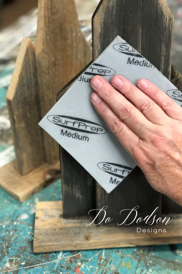 The DIY wooden churches were distressed with a medium grit sanding pad to give them that rustic look.