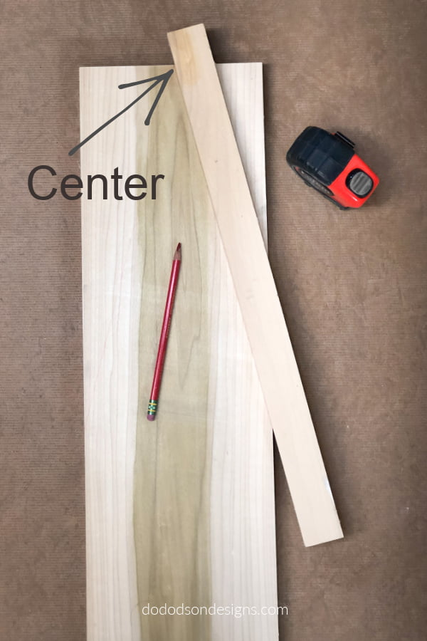 Find your center and draw a line to the point where you want the roof line to stop and repeat on the other side.