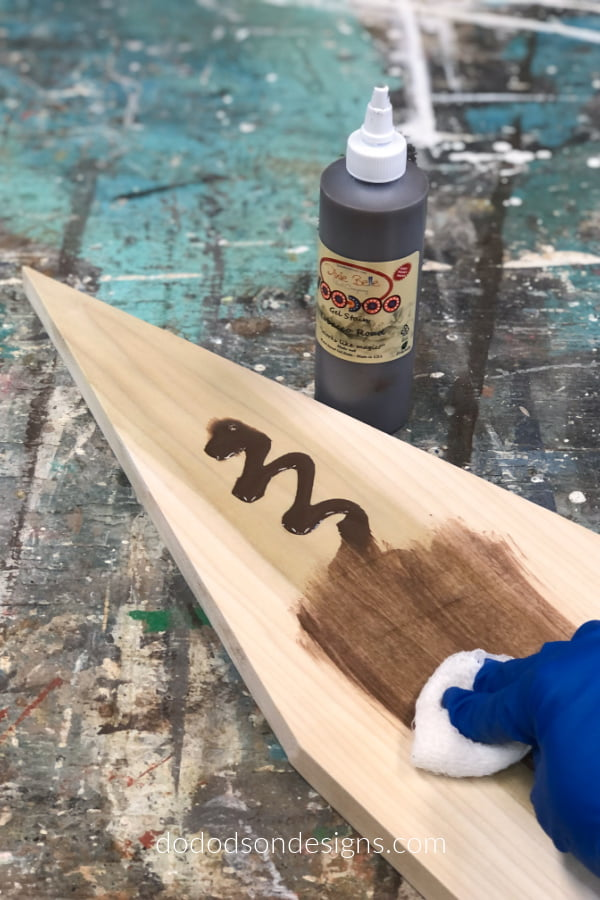 I stained the board using a water-based stain before painting it.
