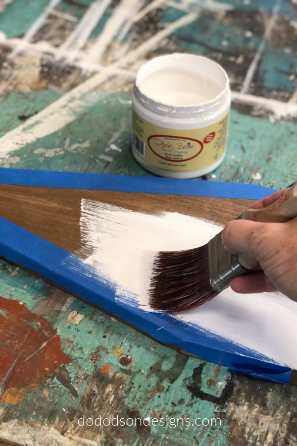 Paint over the wood church using a chalk mineral paint and remove the tape immediately afterwards.