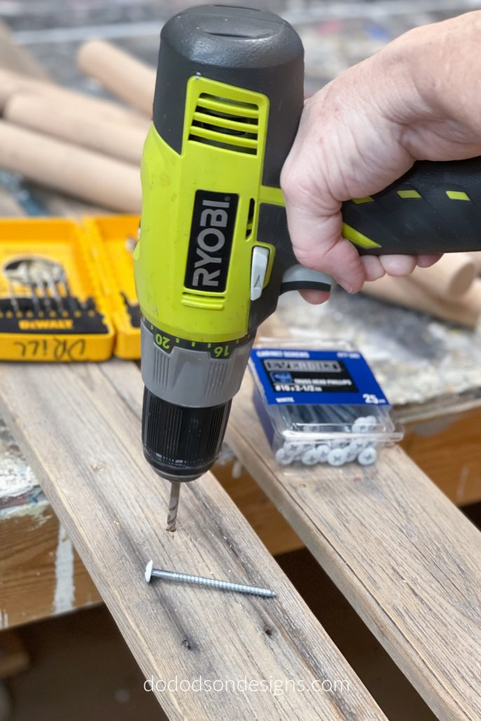Predrill the holes in the rails using a drill bit just a size bigger than the wood screw. You'll want it to slide through the hole but be snug. This will eliminate cracks and splintering of the wood when it's drilled into place on your blanket ladder.