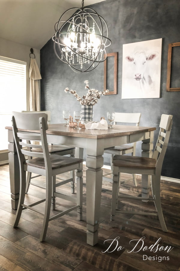 I refurbished this farmhouse pub style table and chairs with grey chalk paint and refinished the wood on the seats and table top. Isn't it stunning?