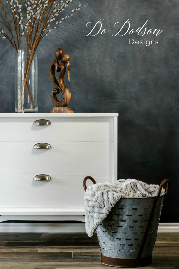 White is definitely the hardest color to paint with but the result are stunning when it's done correctly. I used a good stain blocker on this MCM dresser  before using chalk paint to assure that the white stays white.