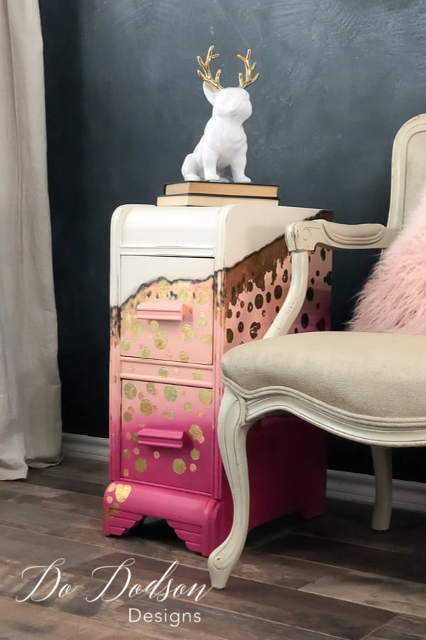 For the little girl inside me that screams to get out every once in a while... I created this bold whimsical look on this repurposed vanity turned side table using chalk paint colors in Peony, Apricot and Butter Cream. Of course I had to add a touch of gold leaf.