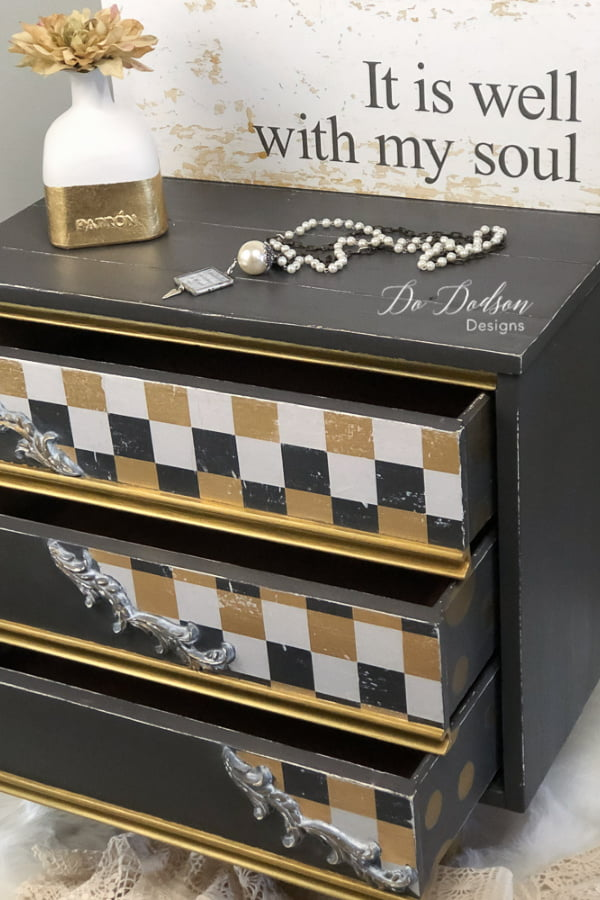 Whimsical black and gold attitude was easy to create on this MCM side table. I used chalk paint and wrapping paper. Yep! It's so stinking cute now.