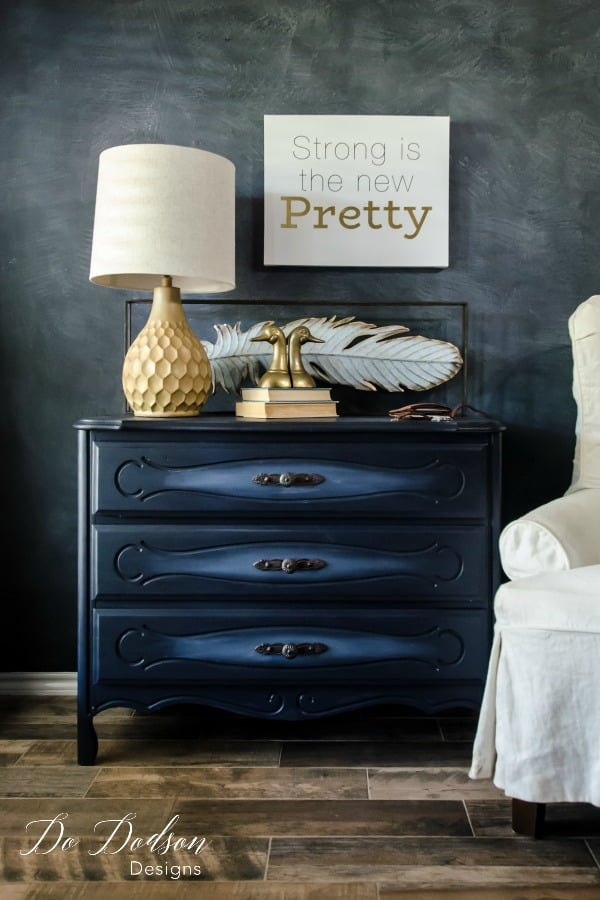 In the navy is an amazing deep shade of blue by Dixie Belle Paint. Chalk paint never looked so good on this refurbished dresser.