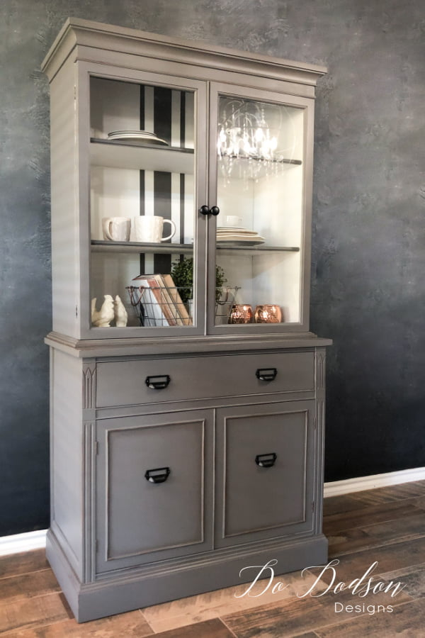Bring on the gray, baby! This gorgeous gray hutch with french grain stripes was painted with Dixie Belle chalk paint in Hurricane gray.