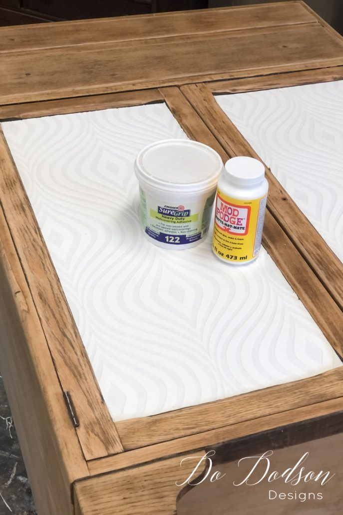 I like adding paintable wallpaper to cabinet dressers like this one. The recessed areas on the doors are perfect for this update. It's an easy DIY furniture makeovers.