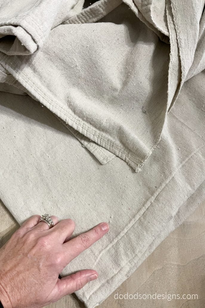 DIY Drop cloth curtains are by no means perfect but do add an earthy organic feel if you love the farmhouse style.