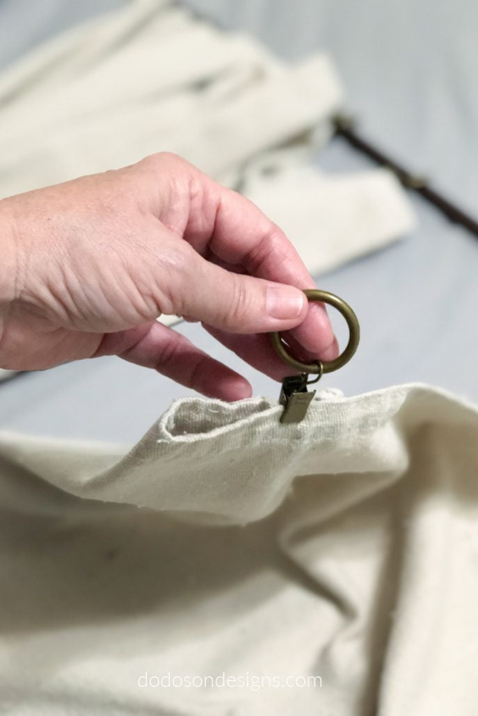 I used curtain ring clips to make pleats in my DIY drop cloth curtains before hanging.