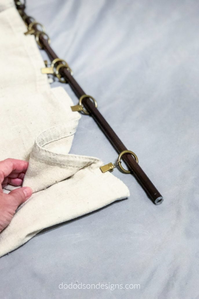 Curtain ring clips are the perfect option for hanging DIY drop cloth curtains.