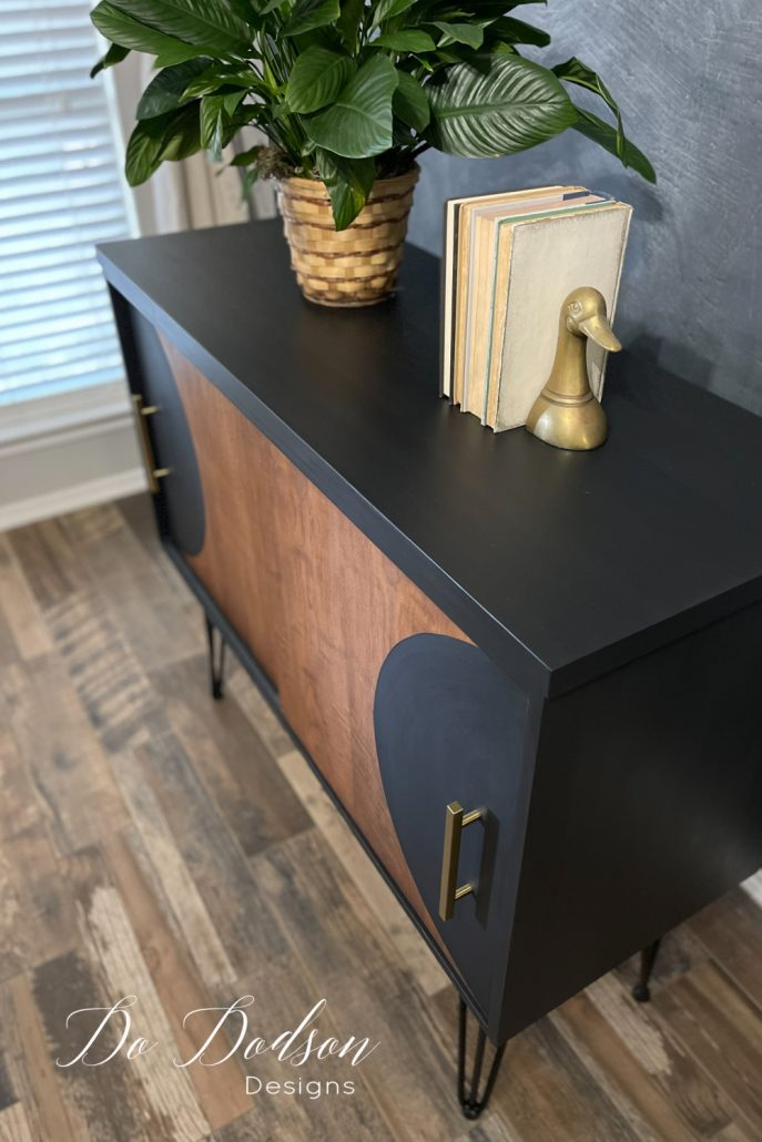 Learn how I painted over this 1970s piece of laminate furniture and gave it an edgy feel. I love the modern vibe!