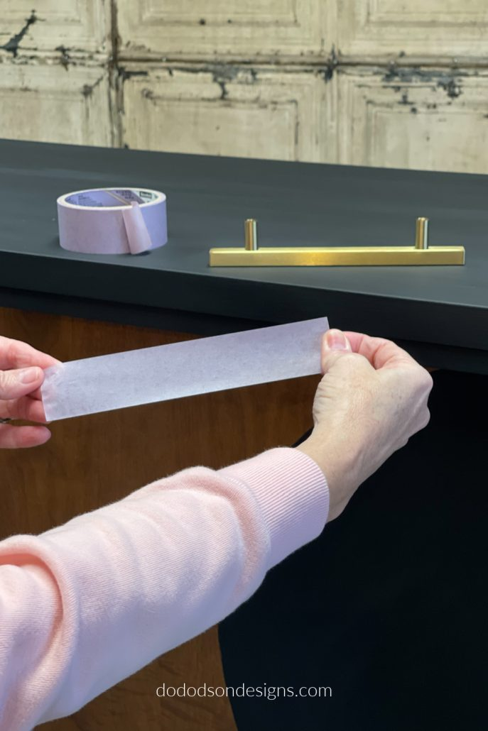 How To Replace Dresser Hardware... First, measure the length of your hardware (cabinet/dresser pulls) and cut a piece of painter's tape the same length as the hardware. This will be your guide for the perfect placement.