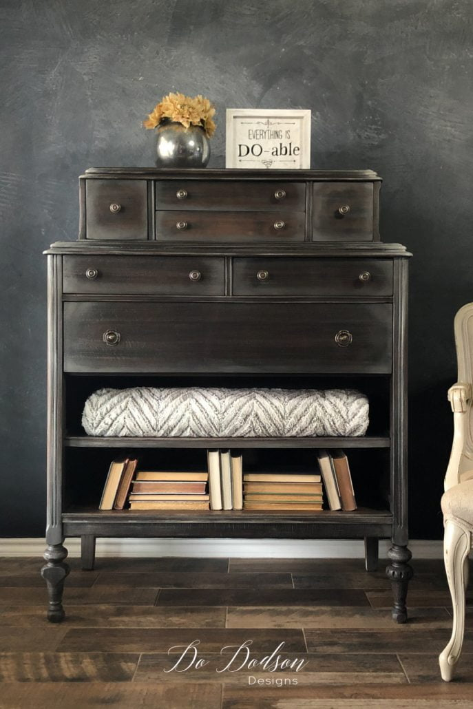 This style is one of my favorite ways to decorate inside a narrow bookshelf, or a missing drawer turned into a shelf like this vintage dresser. While I love symmetry, I also like to mix things up a bit to give the eyes a place to travel. This makes for an interesting pattern when decorating with books.