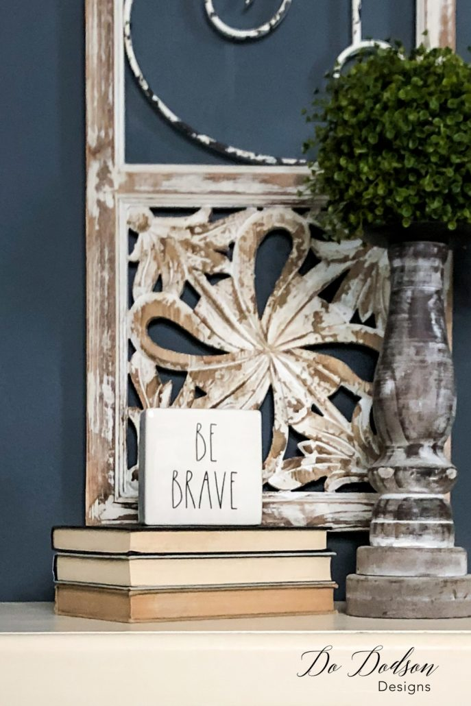 Display your favorite sign or quote on a stack of books for a stylish design element. I like the playfulness and the reminder to be brave, take risks, and allow the unexpected in home decorating. I have a lot of that! It keeps things interesting when decorating with books.