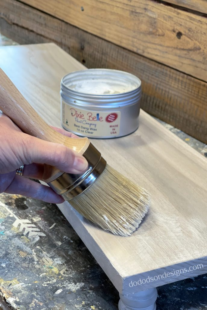 Apply clear wax over the table riser with a quality wax brush and buff with a soft cotton cloth. This will also fill on any open grain in the wood for a super smooth finish.