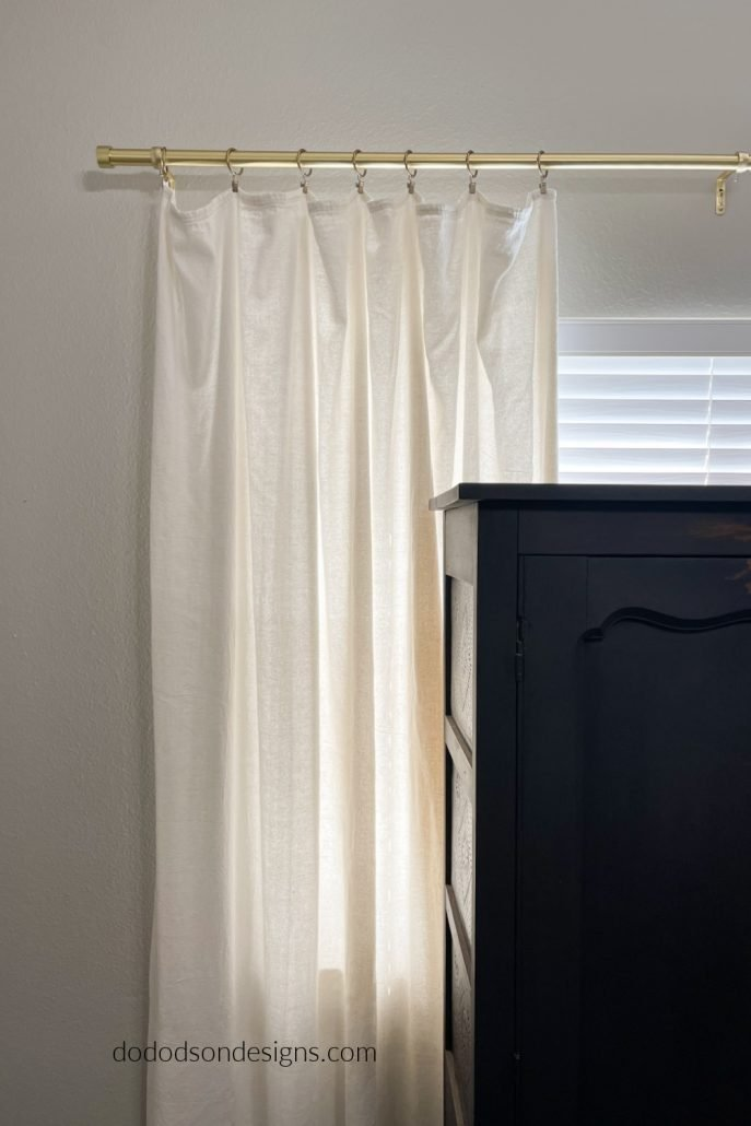 Try hanging your DIY drop cloth curtains with ring clips like this if you want a more laid back, casual farmhouse style.