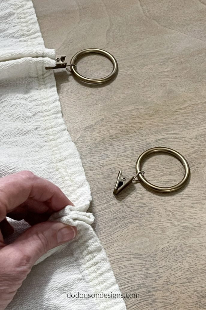 Try adding these simple pleats using curtain ring clips to hang your DIY drop cloth curtains.