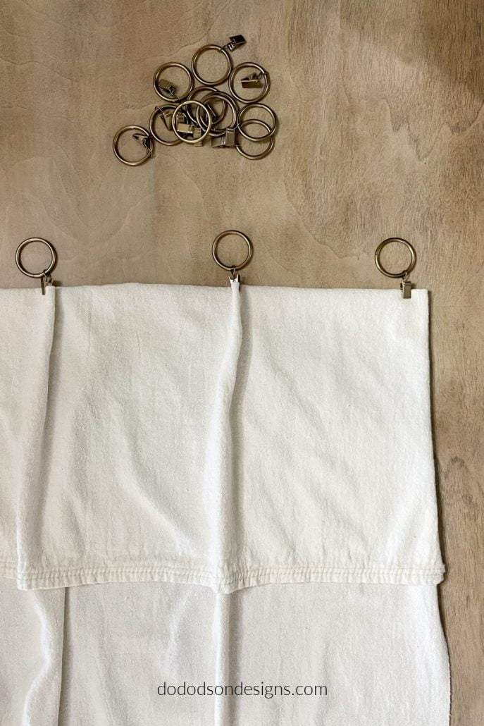 I created a valance with my drop cloth curtains and hung them with curtain ring clips for a traditional look.