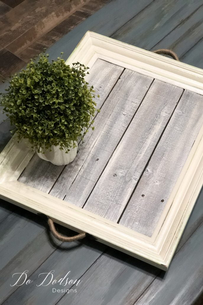 Got wood scraps?! Make this easy DIY picture frame tray. The thrift store and Goodwill are full of these old frames, and they're perfect for this unique coffee table tray. Cha-ching! $$$
