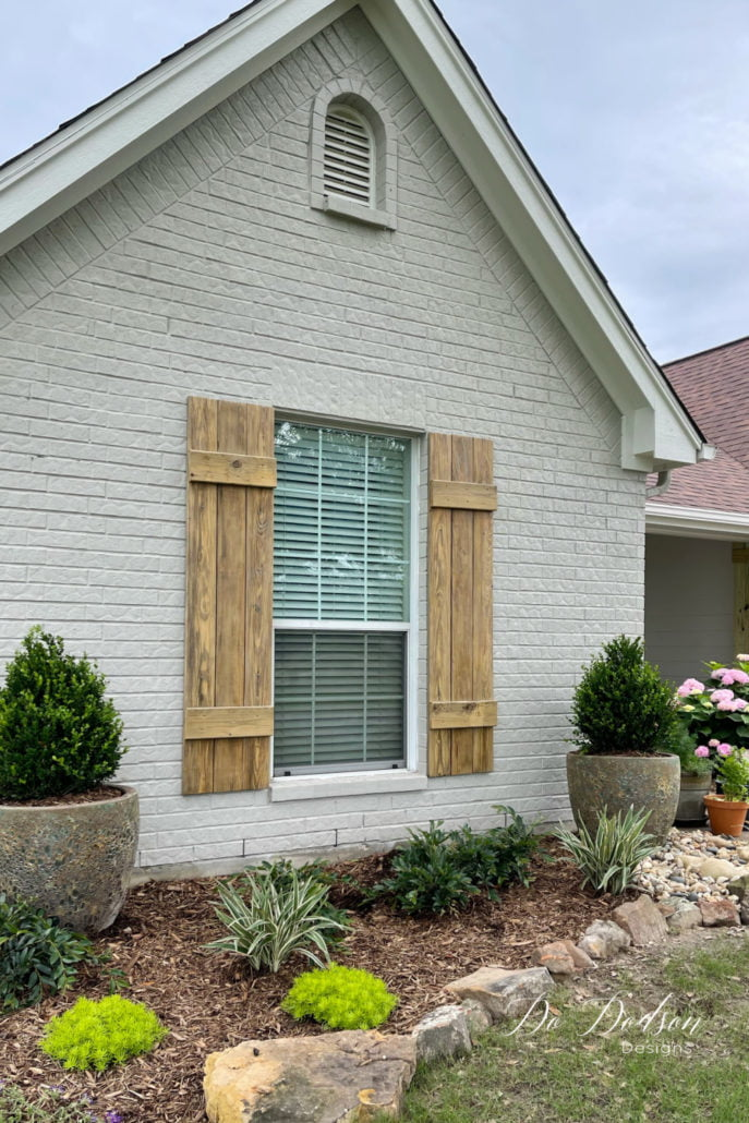 The grass is starting to green up, but my shrubs had seen better days after the hard sub-zero Winter we had here in Texas. We lost a lot of plants. So we did a major overhaul with new landscaping. I think it's a nice compliment to my new DIY wood shutters. Learn how to make them for your windows on the blog.