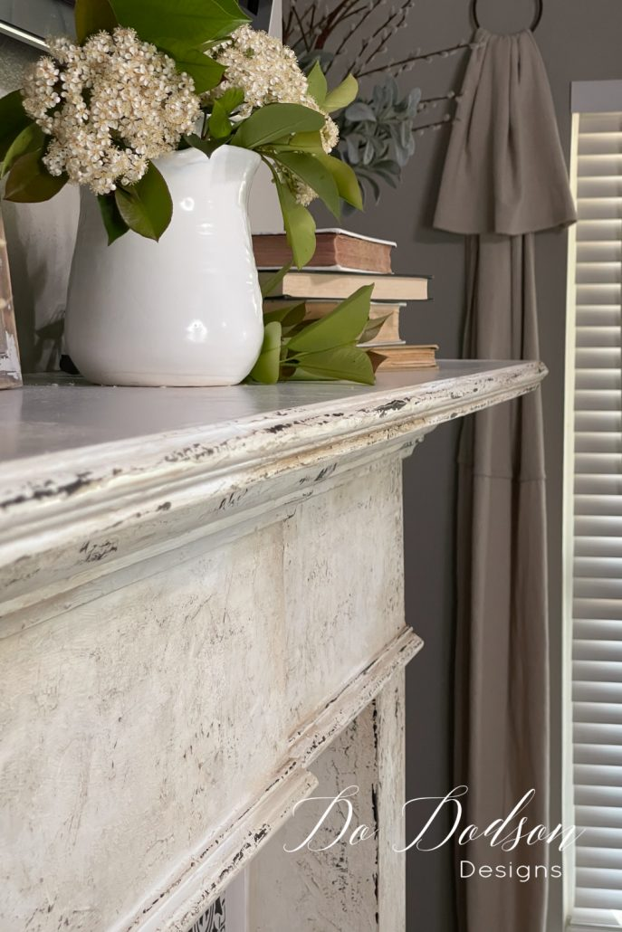 I couldn't love my my fireplace mantel more after adding this DIY chipped paint look. Learn this technique and get the full tutorial on my blog.