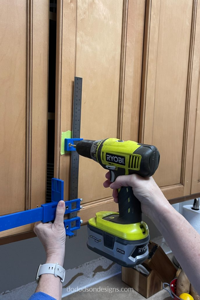 Before drilling those holes in your beautiful wood kitchen cabinets for new hardware, make sure to get perfect hole alignment with this cool tool.