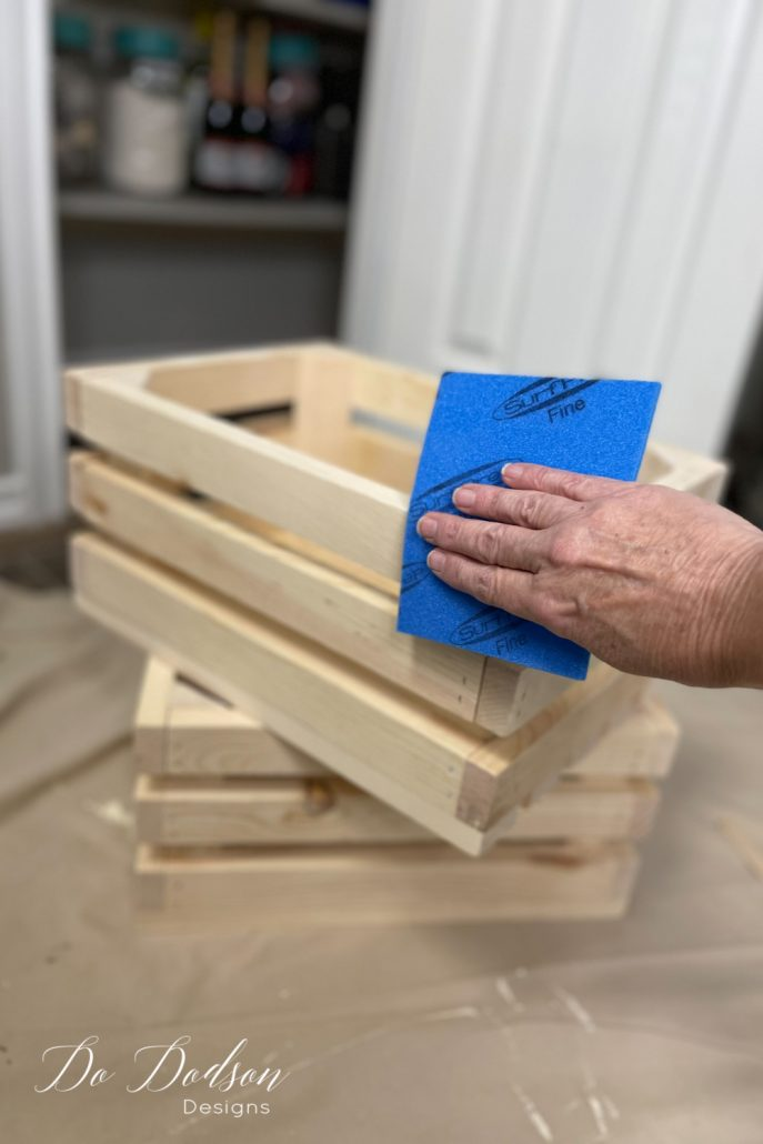 These wood crates are super sturdy and also a bit rough. It's a good idea to sand them with a 220 grit sanding pad before you finish them out and using them for storage in your pantry.